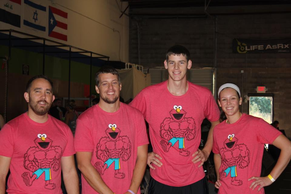 Wes, second from the left, competing at a past CrossFit competition.